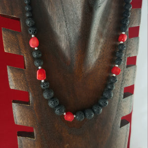 Long Coral stone lava necklace a mix of large and small lava rock beads with red coral stones