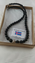 Load image into Gallery viewer, Lava Stone Necklace with Tibetan Silver Charm