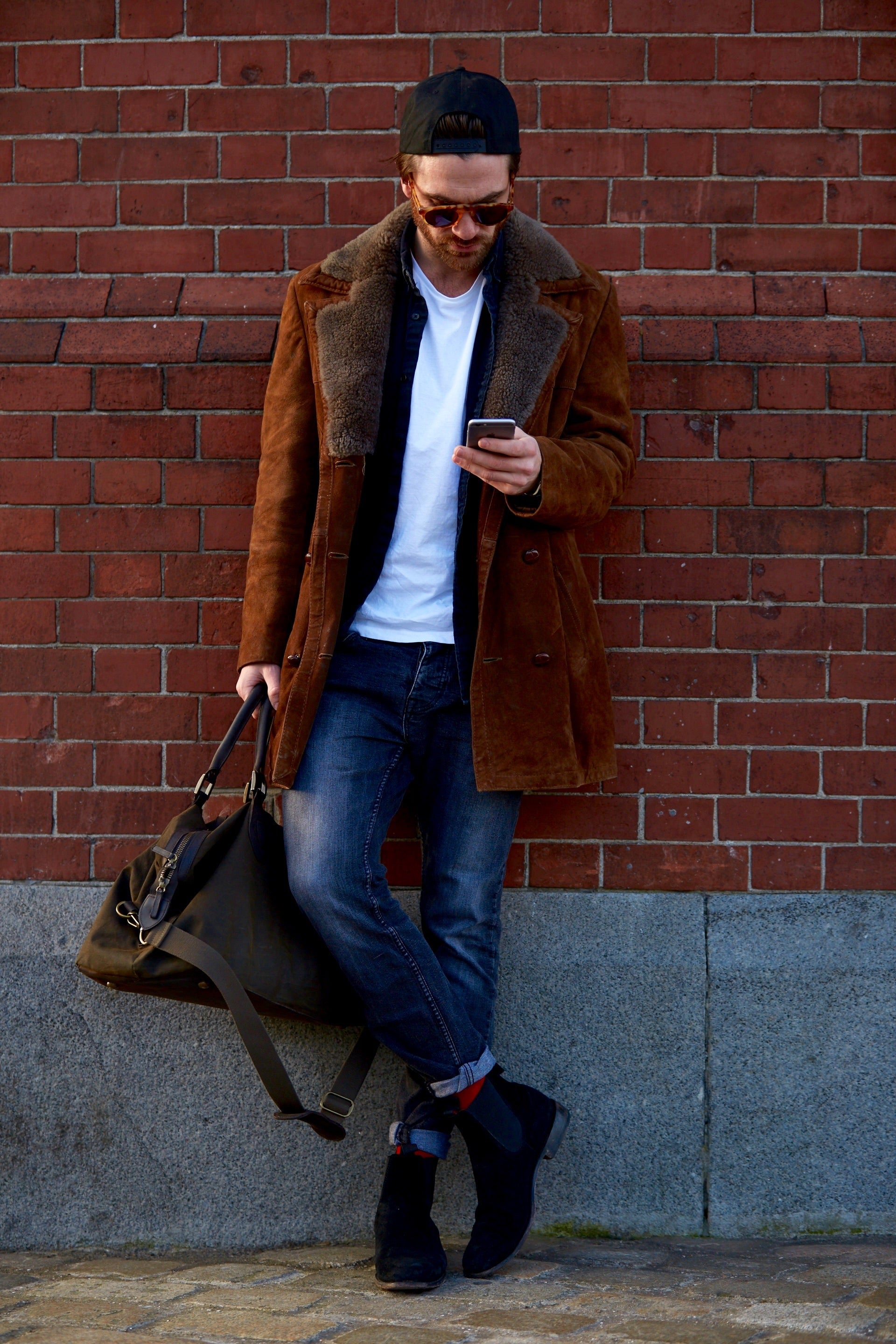 """an image of a model wearing gilmour and gray chelsea boots"""