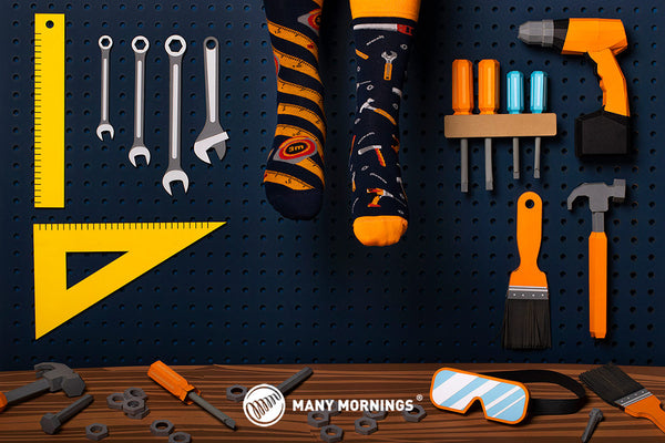 Pairpairfull - Many Mornings The Handyman Mismatched Adult Socks on Feet in papercut art set with screw drivers, goggles and spanner
