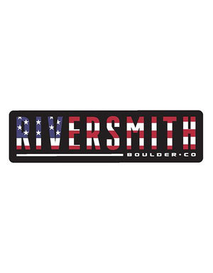 Sticker says Riversmith in large text and Boulder CO in smaller text. Background is black and wide text in red, white, and blue colors from the American flag.
