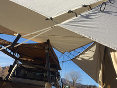 The wing slits allow the awning to by high or low