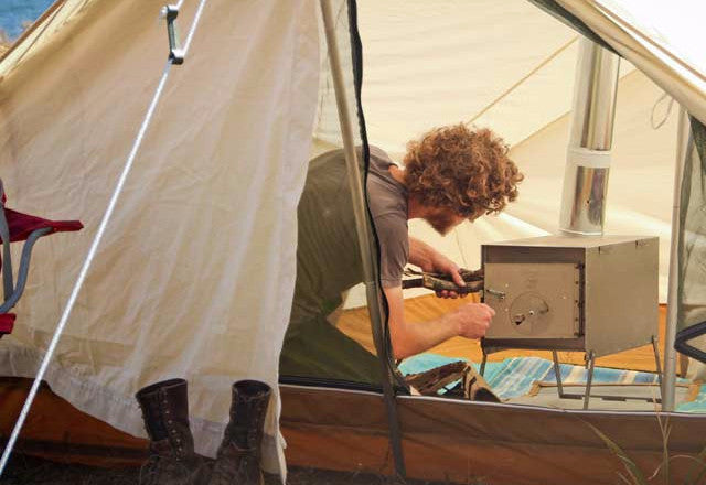 ... Caleb Works The Stove In an 8x10 Torrent & Prairie Stove Jack - Ellis Canvas Tents