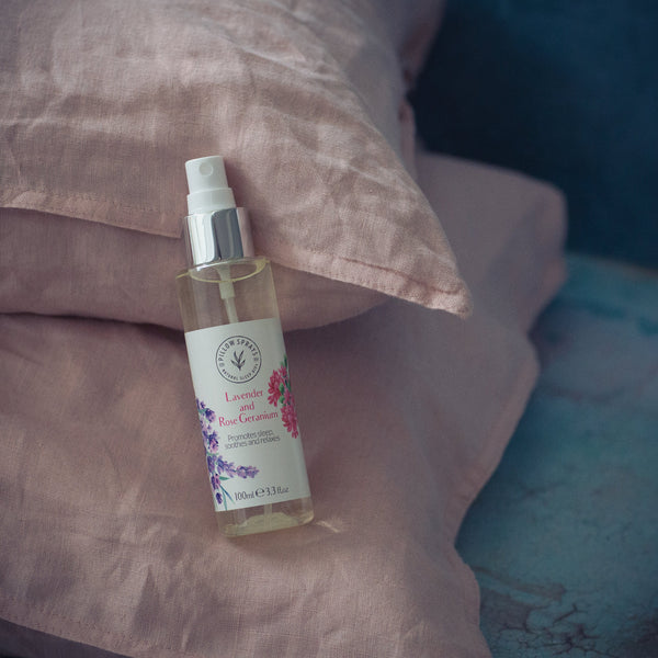 A Lavender and Rose Geranium Pillow Spray on a bed.