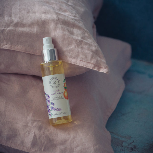 A Lavender and Mandarin Pillow Spray on a bed
