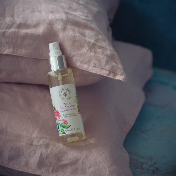 A Neroli, Rose Geranium and Frankincense Pillow Spray on a bed