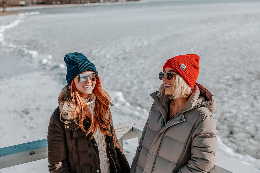 two girls wearing beanies in the winter