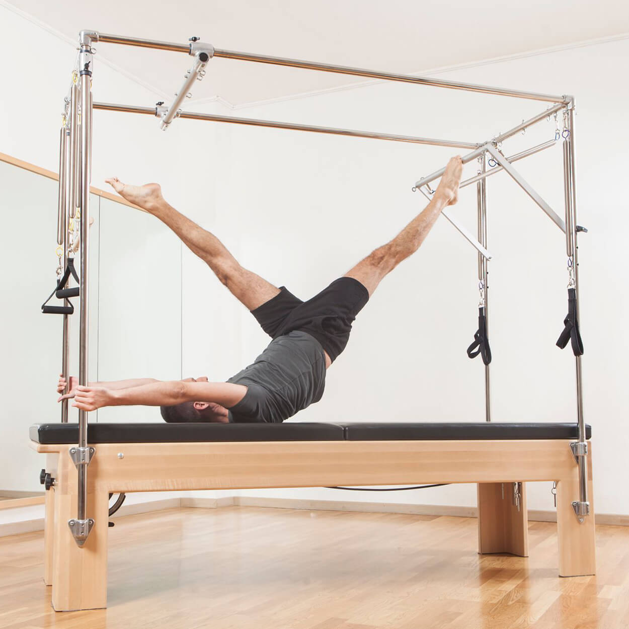 The Pilates Cadillac: The Most Versatile Pilates Training Tool - Pilates Reformers Plus