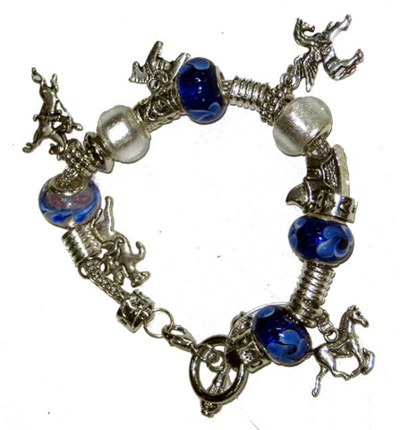 Wild Brumby Saddlery for Geelong, Lara, Werribee. European Tibetan Silver Horse Charm Bracelet With Glass Beads. Equestrian lifestyle and fashion.  Jewellery is handcrafted and exclusive to Wild Brumby Saddlery.  Blue, white and silver. 5 x horse charms. Toggle fastener