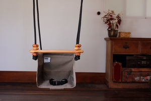 converted childrens swing, safe sensory baby swing indoors made from fabric and wood