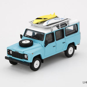 Land Rover Defender 110 Light Blue w/ Surfboard