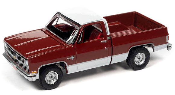 Auto World 1:64 1982 Chevrolet Silverado 10 in Carmine Red with White Roof and Lower Sides