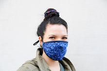 Load image into Gallery viewer, young woman wearing a blue cotton mask with birds, flowers and rabbits on it