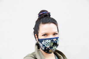 Young-woman-wearing-facemask-with-ethno-pattern-design