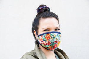 Young woman wearing a facemask featuring colourful flowers