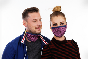 Couple with purple reusable face mask matching
