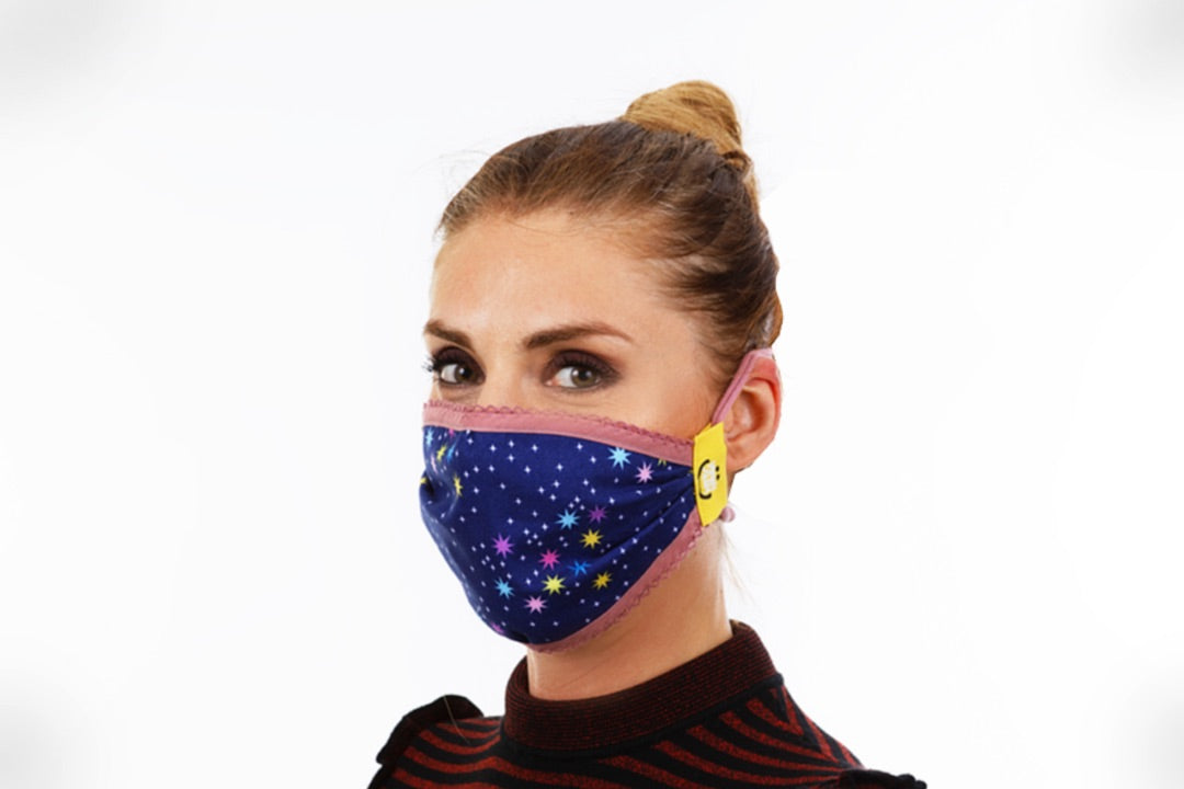 Girl is wearing facemark with star pattern