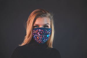 Girl with reusable face mask with candy print