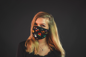 girl with reusable face mask with cartoon print