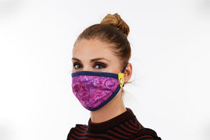 women is wearing purple face mask with happy mask logo