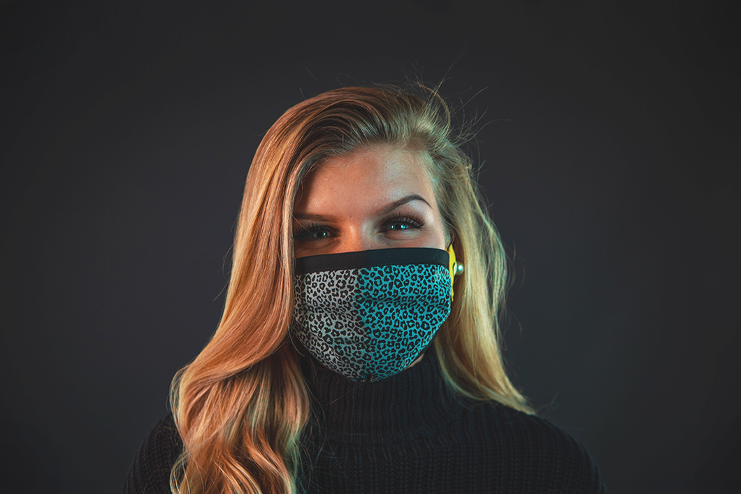 blond girl with reusable face mask leopard print green