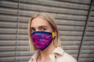 blond girl is wearing reusable pink face mask