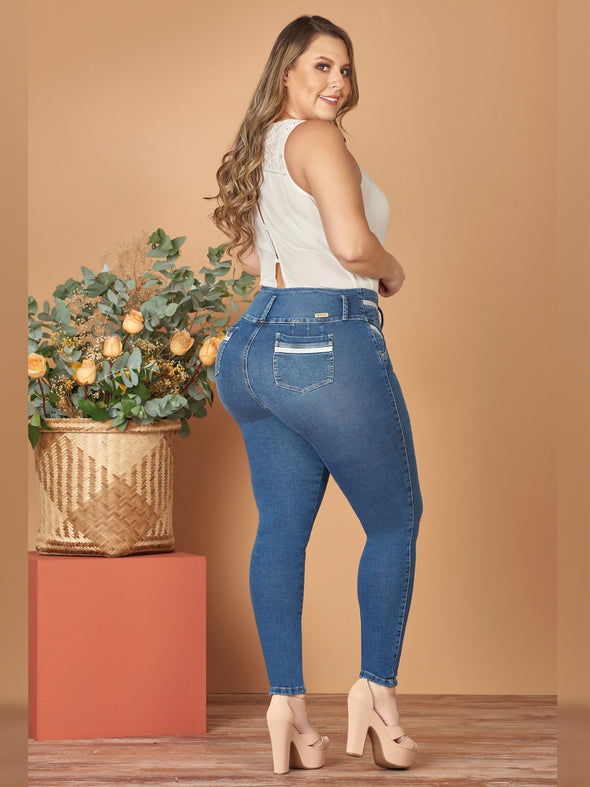 plus size colombian woman skinny jeans white bodysuit nude high heels