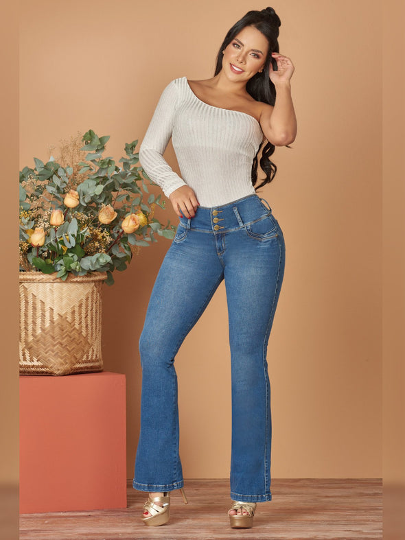 colombian woman wearing boot cut light wash jeans high heels and one shoulder top
