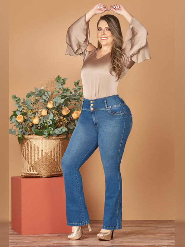 plus size colombian woman with boot cut jeans silk blouse and heels
