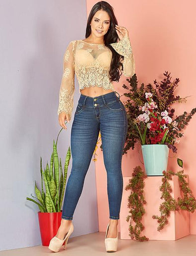 colombian woman with dark long hair wearing lace nude top and butt lift colombian skinny jeans with heels
