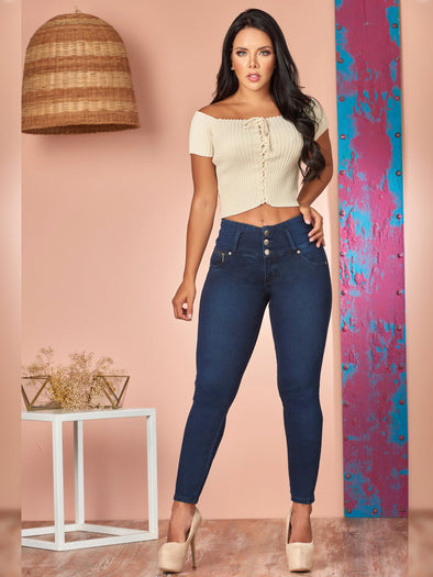 dark wash skinny butt lift jeans with cream crop top and nude heels