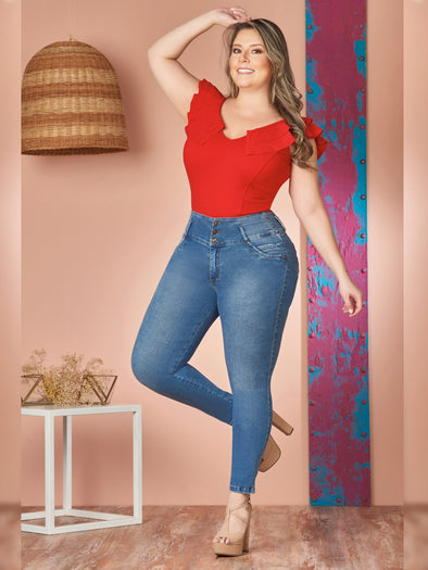 plus size model with red ruffle bodysuit skinny colombian jeans and nude heels