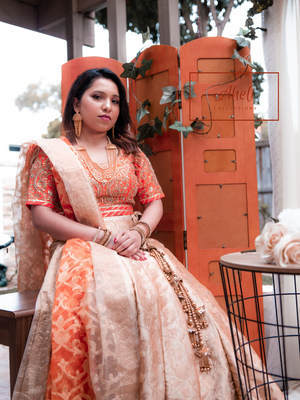 Cream And Orange Lehenga