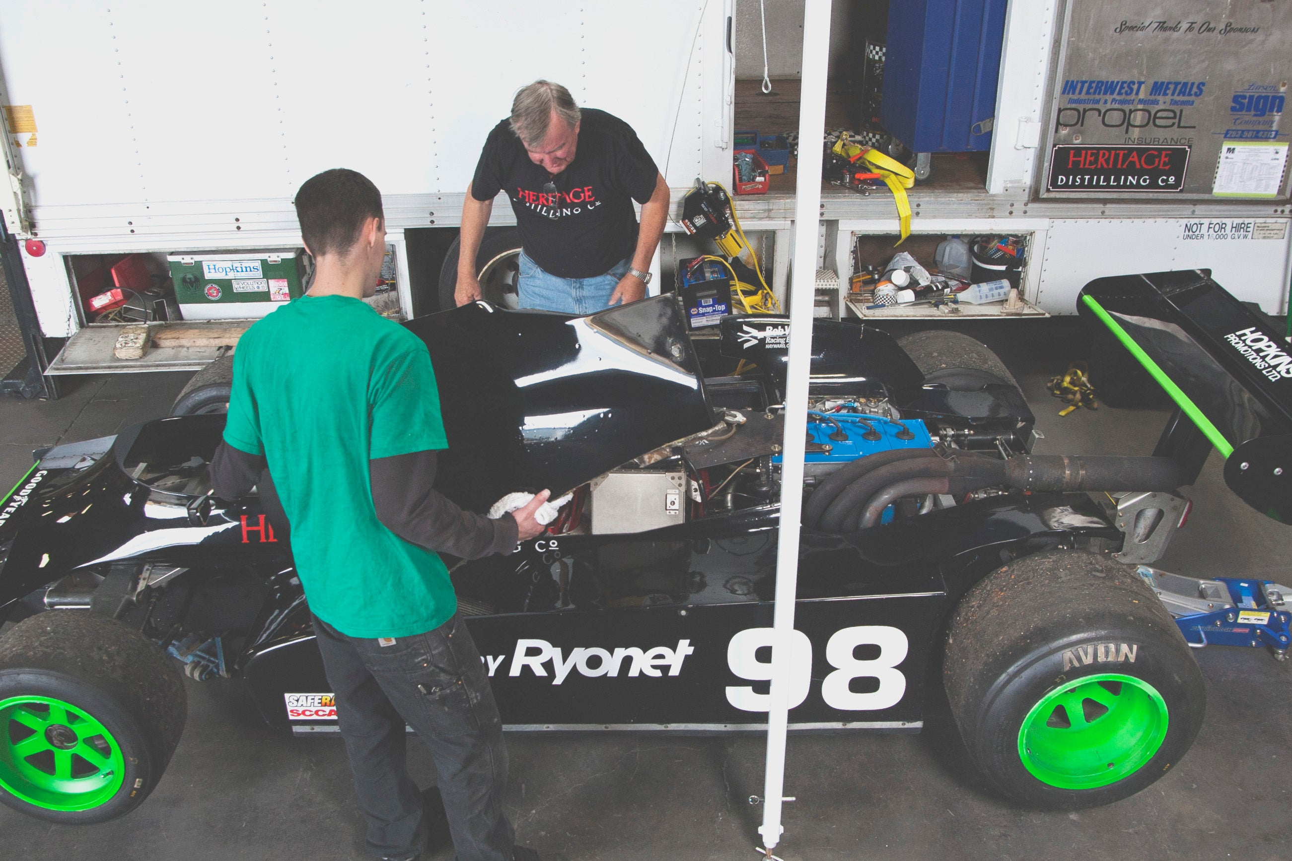 Riley Hopkins looking over his Race Car He Built.