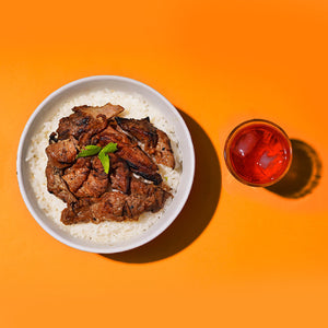 Pork BBQ over rice with red iced tea