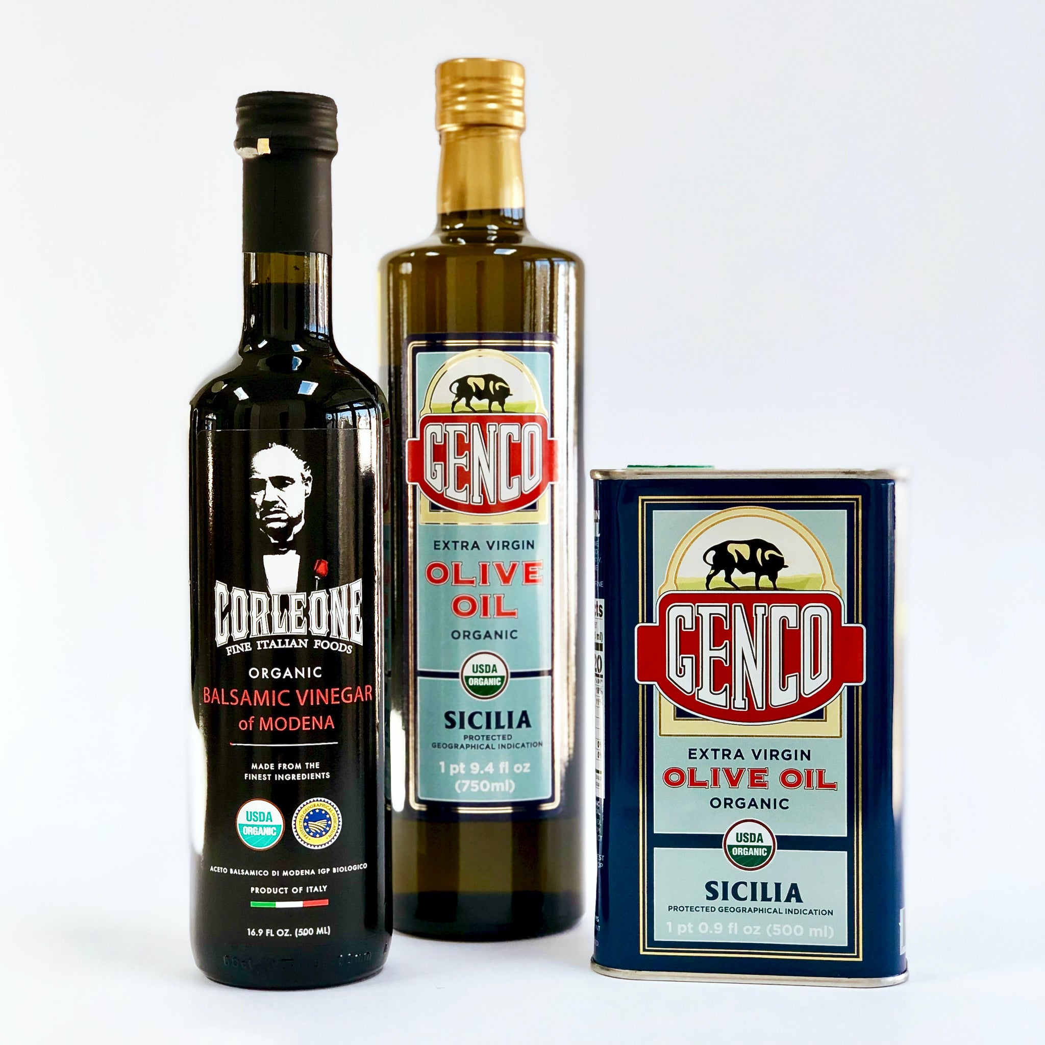 Corleone Fine Italian Foods bottle of balsamic vinegar and bottle and can of Genco olive oil
