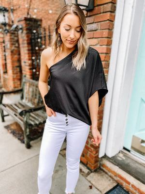 "<img src=""One-Shoulder-Textured-Blouse-Black-Full.jpg"" alt=""one shoulder textured blouse in black full view"">"