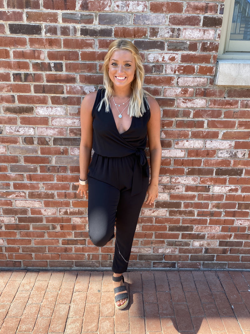 "<img src=""Tie-Front-Jumpsuit-Pockets-Black-Full.jpg"" alt=""tie front jumpsuit with pockets in black full view"">"