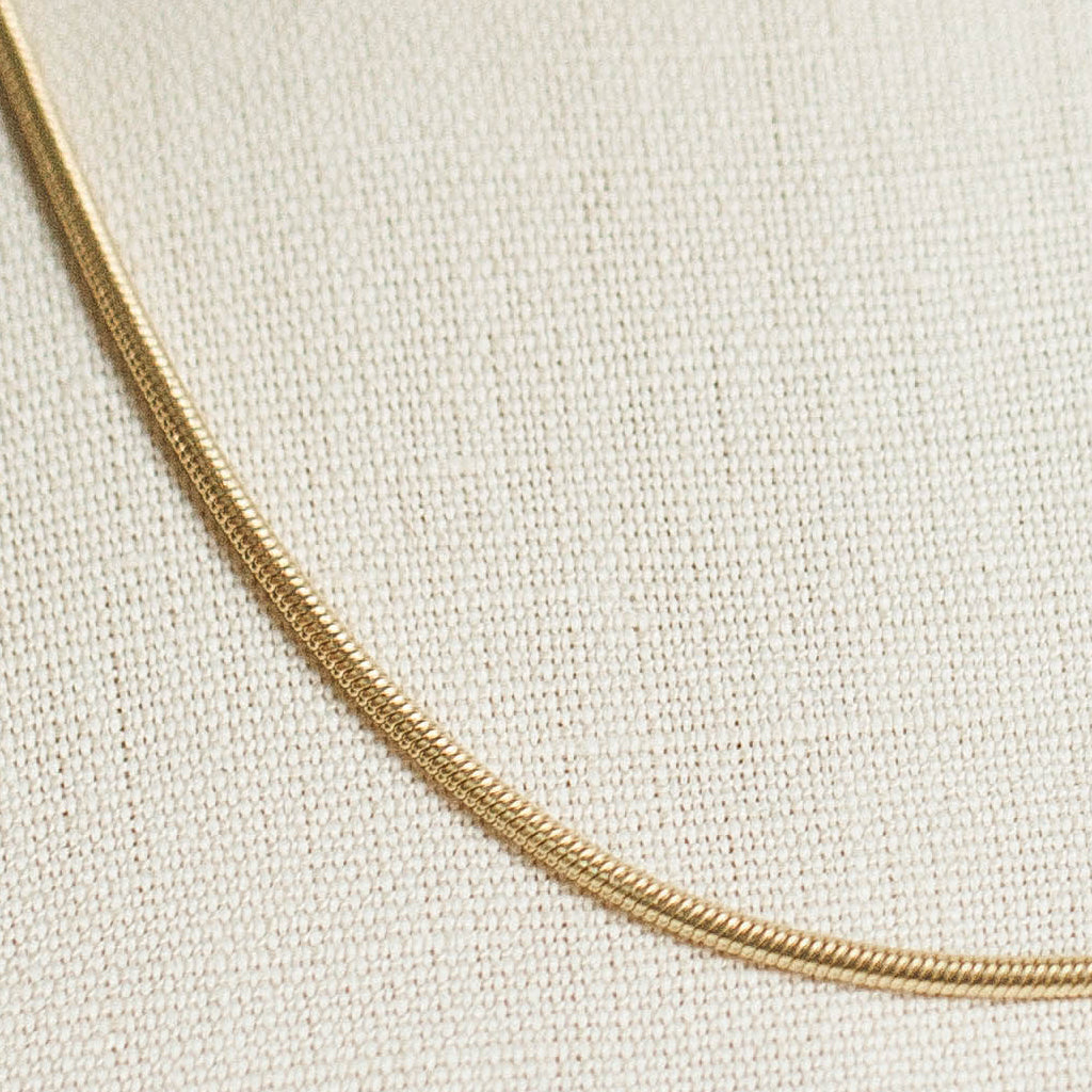 Devi Arts Collective Gold Snake Layering Necklace