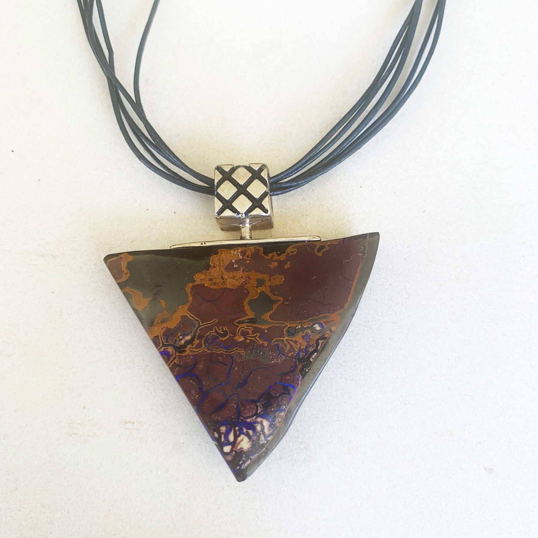 Large triangular boulder opal pendant with artistic pattern