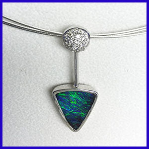 Boulder opal and diamond pendant in white gold