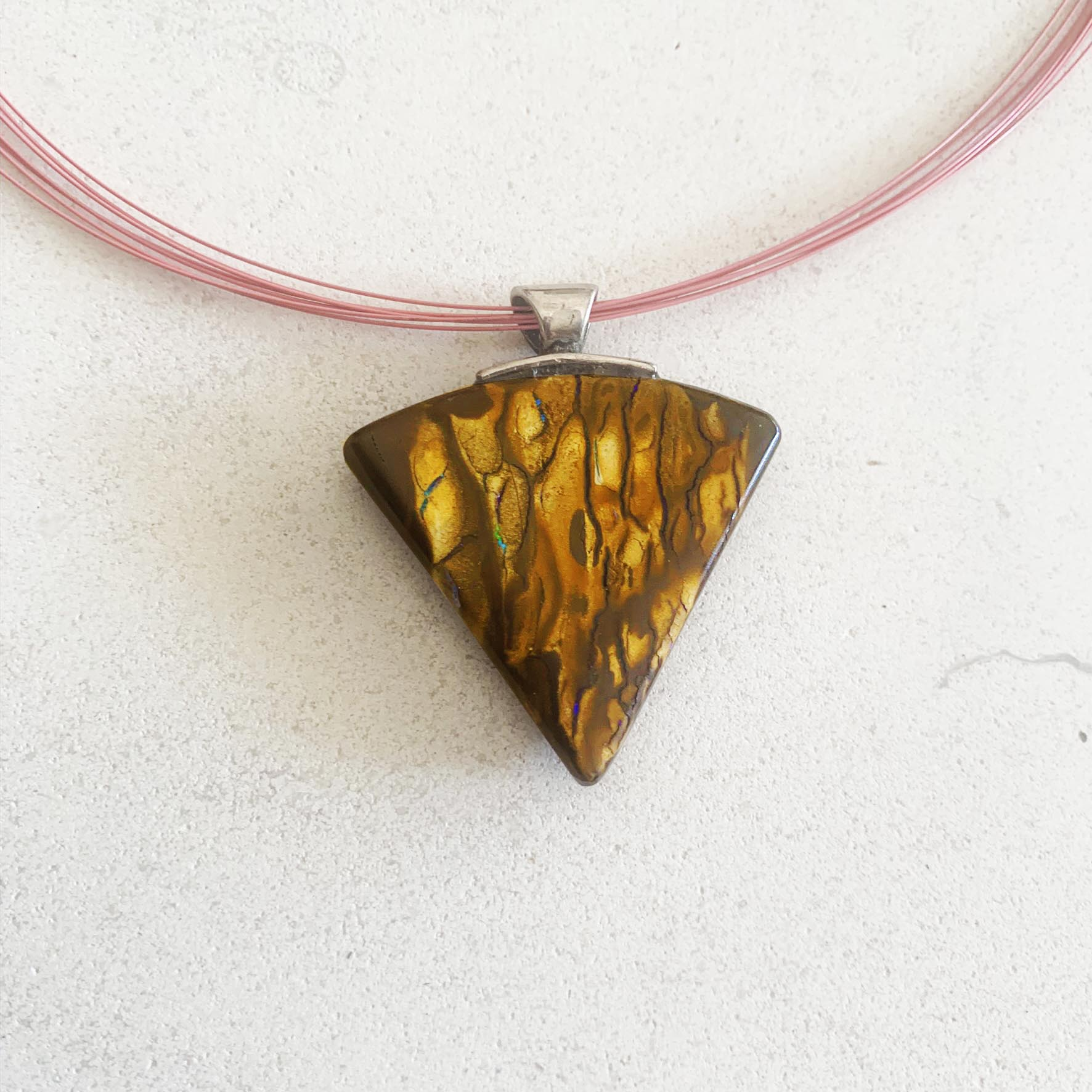 Triangular boulder opal pendant on steel strands