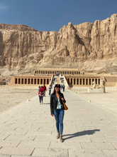 "Load image into Gallery viewer, The Dead Sea - this was Temple for the female pharaoh Hatshepsut. Fun fact - she pretended to be a man!</br></br>Date: 2020-01-12</br></br>Location: Upper Egypt</br></br>Outfit: <a href=""https://www.floatthere.com/search?q=ruffle+top"">Ruffle Top</a>"