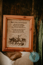 "Load image into Gallery viewer, ""Don't Sell Your Saddle"" Cowhide Sign with Custom Cedar Frame (10X12)"