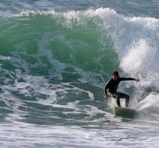 surfing in Sardinia Jst Ride Out