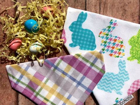 Reversible dog bandana with colorful bunnies on a white background on one side and an Easter plaid coordinating print on the reverse