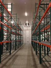 Load image into Gallery viewer, Newly installed pallet racking showing upright frames and beams