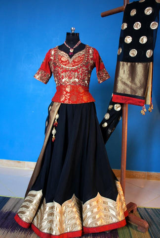 Black georgette lehnga with red brocade choli and dupatta.