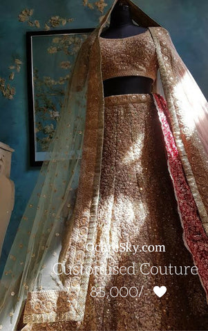 Annpoorna: Almond bridal lehenga with two net dupattas and a red velvet stole.