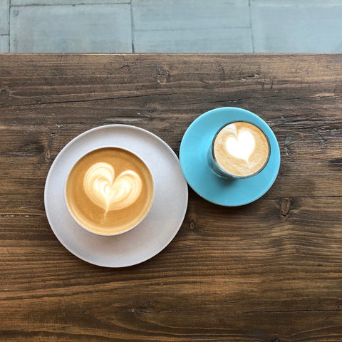 Two coffees with heart latte art